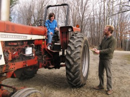Woman farmer on tractor retrofitted with ROPs