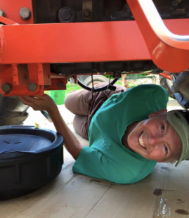 Terry under tractor.png